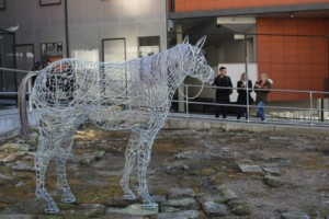 Horse sculpture placed on the archaeological remnants of the stables.